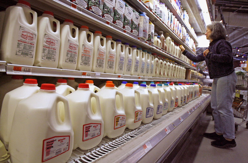 A shopper looks over the milk aisle at a store in Montpelier, Vt. The House rejected a farm bill that would have affected milk prices.