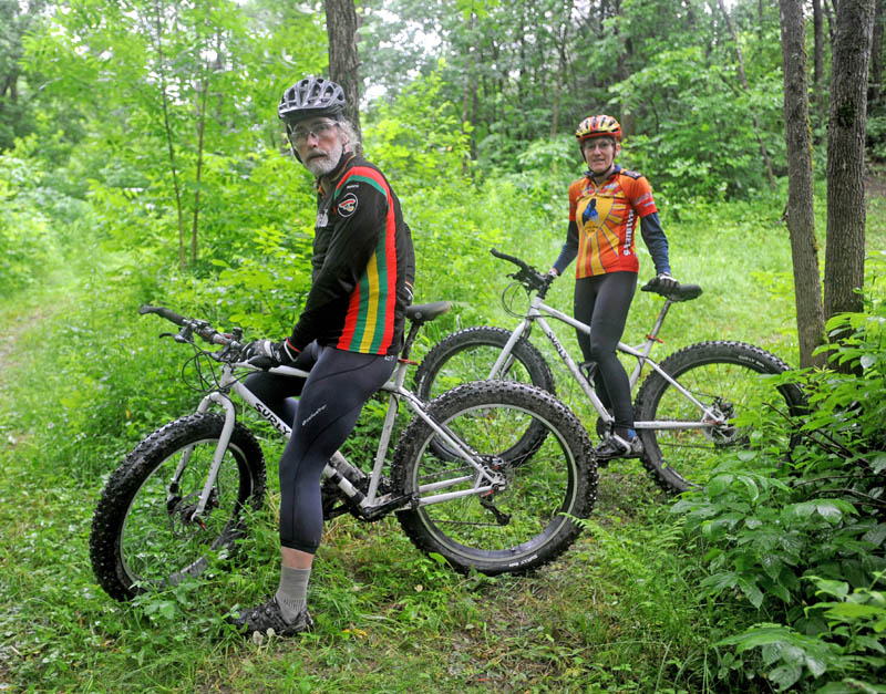 Laurie and Glenn Fenlason, of Winslow, take a ride on one of their many mountain bike trails on their property, known as The Playground.