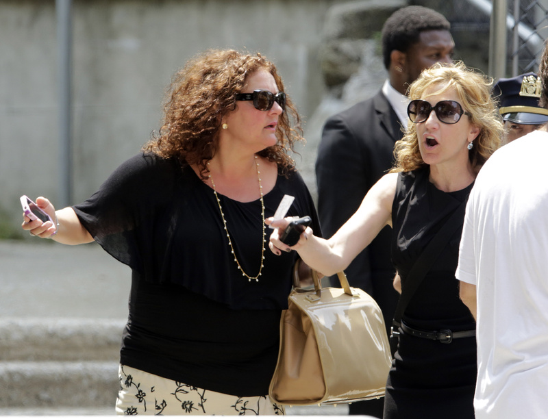 """Actresses Aida Turturro, left, and Edie Falco leave the funeral service of James Gandolfini, star of """"The Sopranos,"""" at the Cathedral Church of Saint John the Divine in New York on Thursday."""