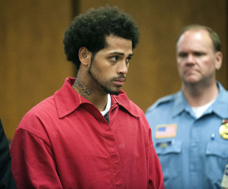 Carlos Ortiz is shown during a hearing in court in Bristol, Conn., on Friday. He was turned over to Massachusetts authorities and pleaded not guilty to firearms charges there later in the day.
