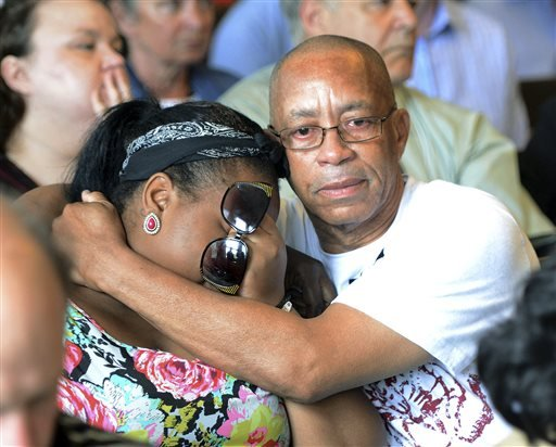 Family of Odin Lloyd react during the arraignment of former New England Patriots tight end Aaron Hernandez in Attleboro District Court Wednesday, June 26, in Attleboro, Mass.