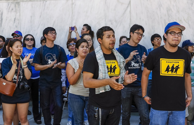 Immigrant students join a coalition of immigrant rights supporters on a 24-hour vigil outside the Federal Building in Los Angeles on Thursday. The group was calling on the U.S. Congress to pass immigration reform.
