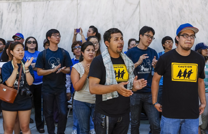 Immigrant students join a coalition of immigrant-rights supporters on a 24-hour vigil calling on the U.S. Congress to pass immigration reform outside the Federal Building in Los Angeles on Thursday.