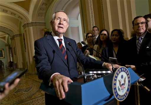 Senate Majority Leader Harry Reid of Nevada updates reporters on the pace of the immigration reform bill following a Democratic strategy session Tuesday on Capitol Hill.