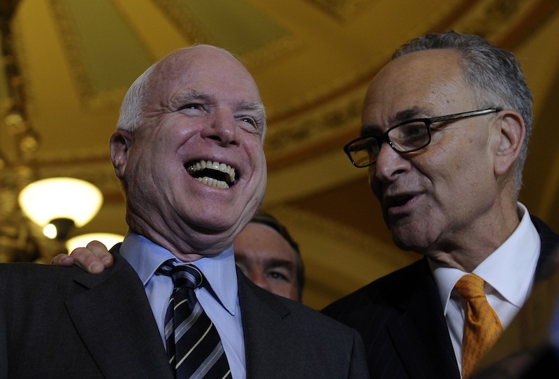 Sen. Charles Schumer, D-N.Y., right, shares a laugh with Sen. John McCain, R-Ariz., following a vote in the Senate on immigration reform on Thursday. The Senate passed historic immigration legislation offering the hope of citizenship to millions of immigrants living illegally in America's shadows. The bill will now go to the House where prospects for passage are highly uncertain.