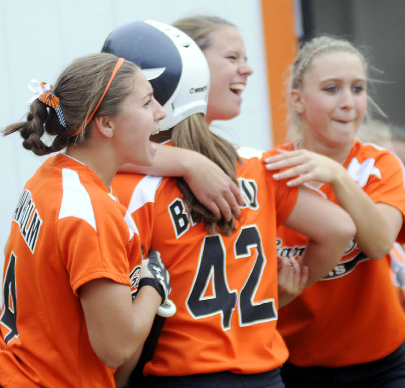 HAPPY DAYS: Gardiner Area High School softball players greet Briana Brochu after scoring Monday against Hermon in an Eastern Class B semifinal game in Gardiner.