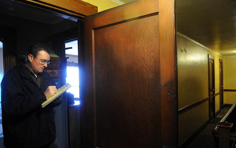 City of Augusta Code Enforcement Officer Robert Overton inspects an apartment in the city on Tuesday.