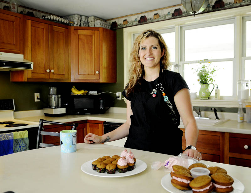 """Jessica Hunnewell received an interest-free loan from the Readfield Enterprise Fund to open Sweet Spot Dog Bakery at her home on Main Street. She whipped up a batch of """"pupcakes"""" and """"woofie pies,"""" with bacon-flavored filling, on Thursday."""