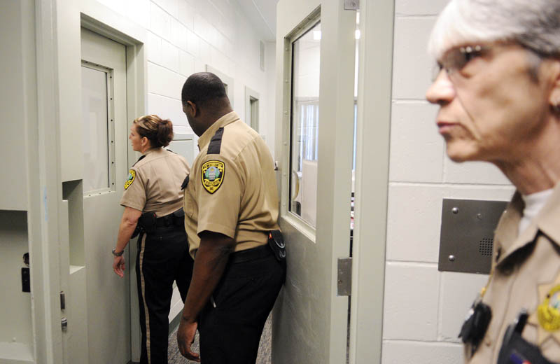 Kennebec County Corrections Facility officers check a cell block Wednesday at the jail in Augusta.