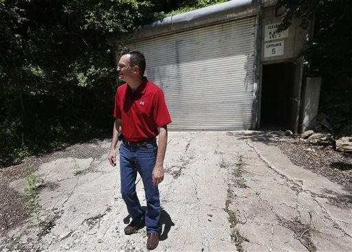 Coby Cullins stands next to an entrance to the Vivos Shelter and Resort during a tour of the facility.
