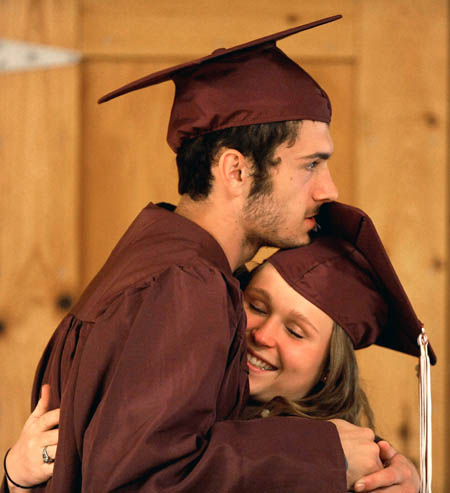 Josh Wheeler and Priscilla Chambers share a hug in the cafeteria at Nokomis High School prior to commencement ceremonies in Newport on Friday.