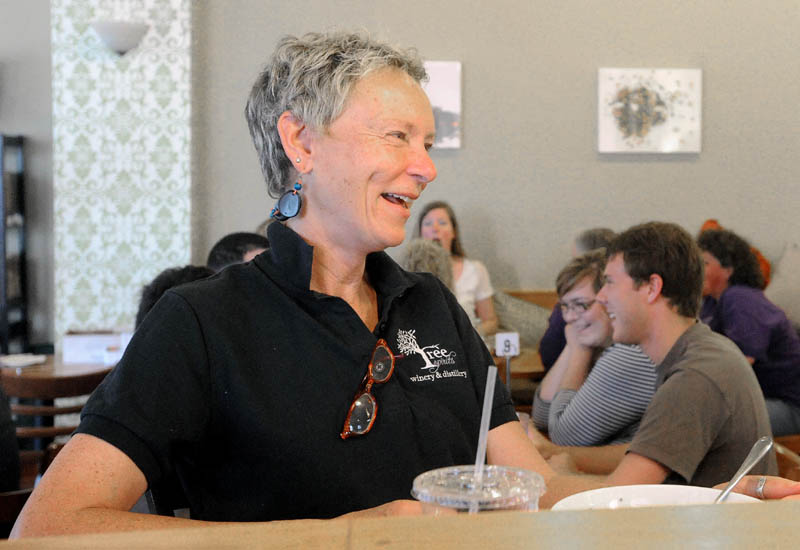 Waterville Mayor Karen Heck, left, chats with a friend during lunch at Selah Tea in downtown Waterville on Friday.