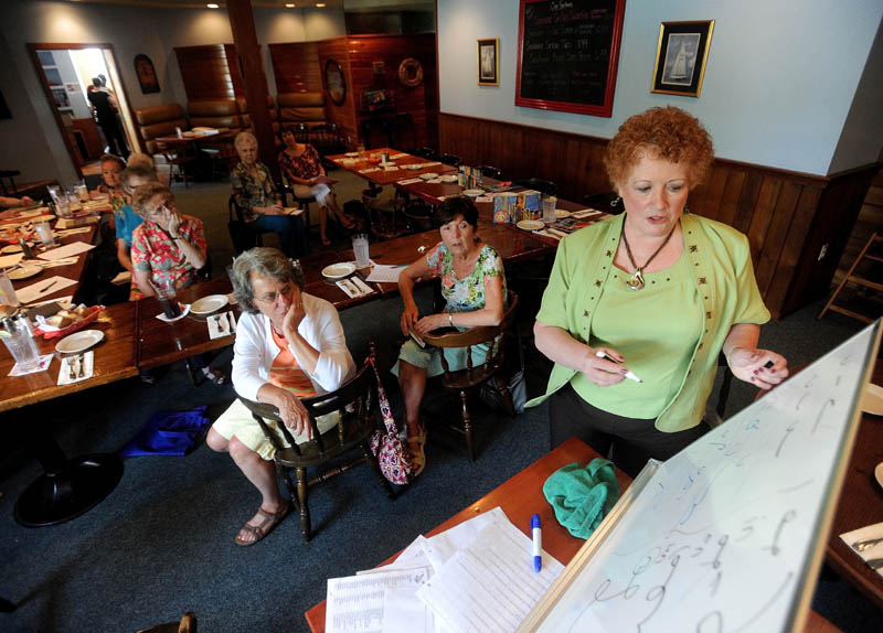 Kay Grindall teaches the finer points of shorthand to the Shorthand Writers of Maine during lunch at the Weathervane Restaurant on Kennedy Memorial Drive in Waterville on Friday.