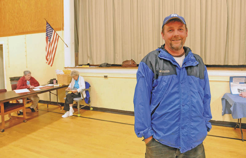 Leo Hill, 42, stands in the gymnasium at Quimby Middle School in Bingham on Tuesday after voting on the Regional School Unit 18 budget.