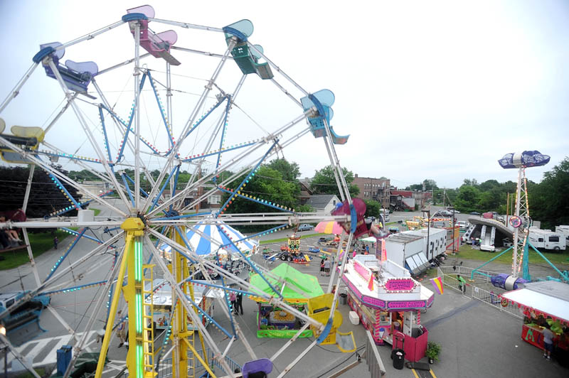The East Coast Midways Ferris wheel dominates the Fairfield Community Days midway in Fairfield on Thursday.