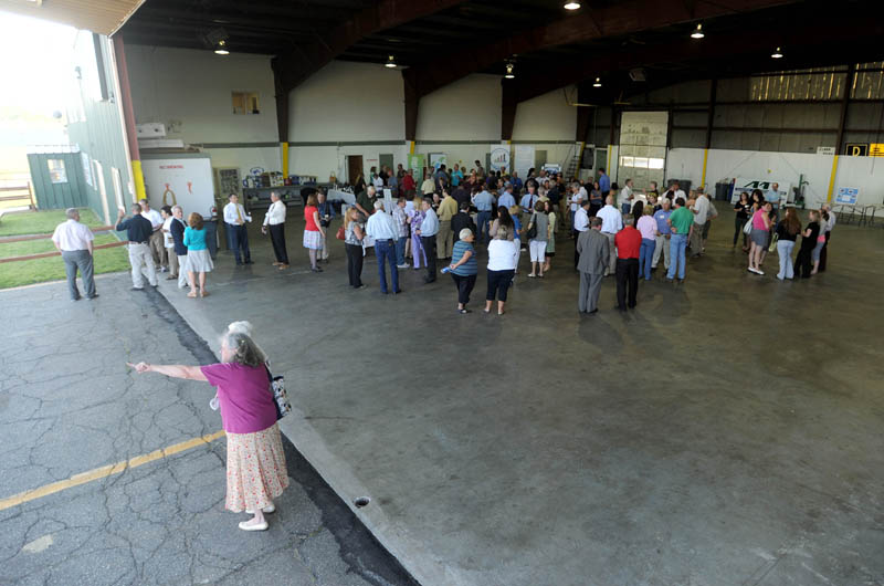 Mid-Maine Chamber of Commerce members gather in the hanger at the newly renovated Robert LaFleur Municipal Airport in Waterville for a Business After Hours event on Wednesday.