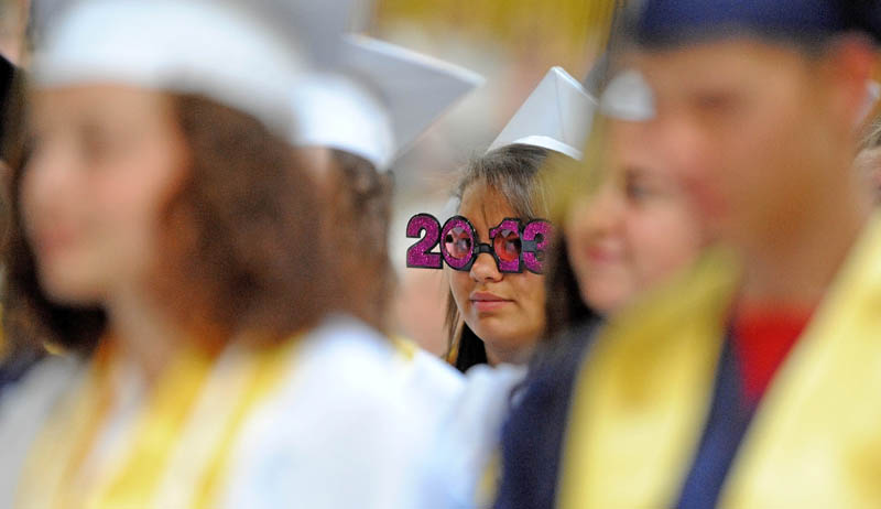 """Caley Miranda, center, sports """"2013"""" glasses during My. Blue High School's commencement ceremonies in Farmington on Saturday."""