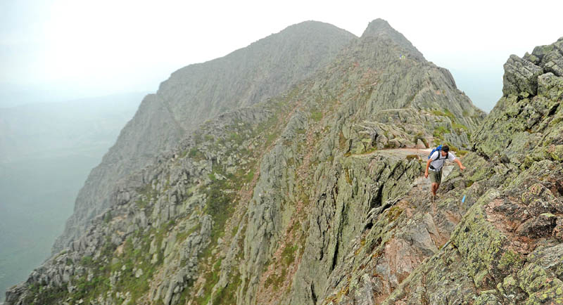 Jesse Hamilton, of Waterville, traverses the Knife Edge on Mt. Katahdin in Baxter State Park on Sunday. Mt. Katahdin is the highest mountain in Maine and the northern terminus for the Appalachian Trail. The Knife Edge route offers spectacular views along it's narrow razor like ridge that connects Pamona Peak to Baxter Peak.