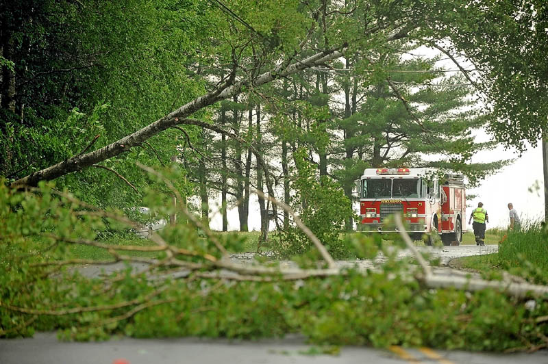 The Madison Fire Department closed a section of Russell Road in Madison on Tuesday after a thunderstorm knocked down trees and power lines.