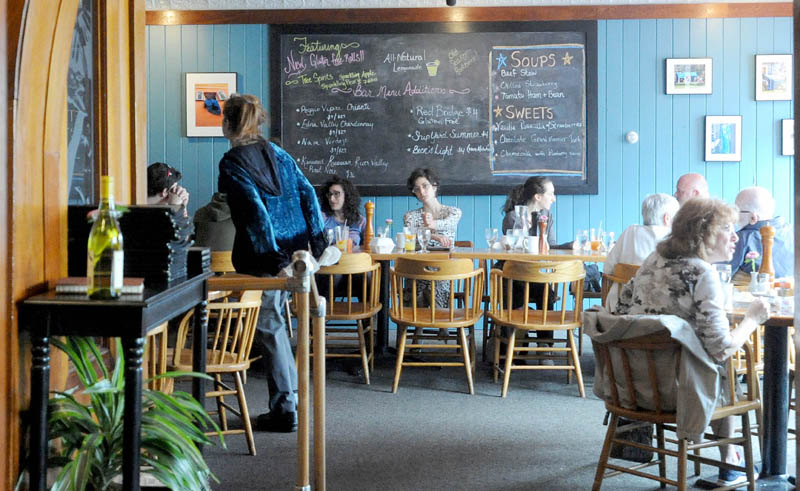 Diners eat lunch at The Last Unicorn in downtown Waterville on Friday.