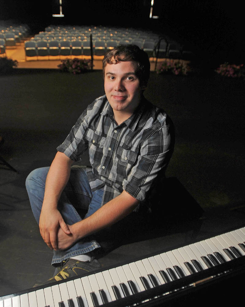 Zander Walz, 26, sits by the piano he will be playing during the Skowhegan Area Adult and Community Education graduation ceremony at Skowhegan Area High School on Wednesday. Walz received a GED and will attend Kennebec Valley Community College in the fall to study radiology.