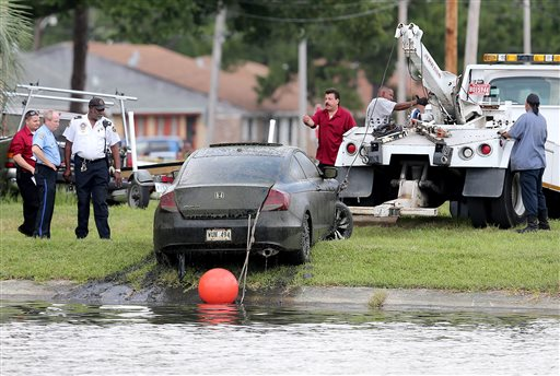 The Honda Accord belonging to teacher Terrilynn Monette, who has been missing since leaving a nearby bar in early March, is pulled from Bayou St. John by the Harrison Avenue Bridge in New Orleans on Saturday.