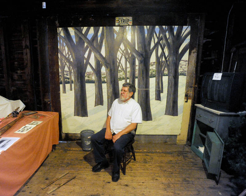 John Verrier, 63, a History House volunteer, takes a break in the barn of the Cotton-Smith House on High Street in Fairfield during the Fairfield Days Community Festival on Saturday.
