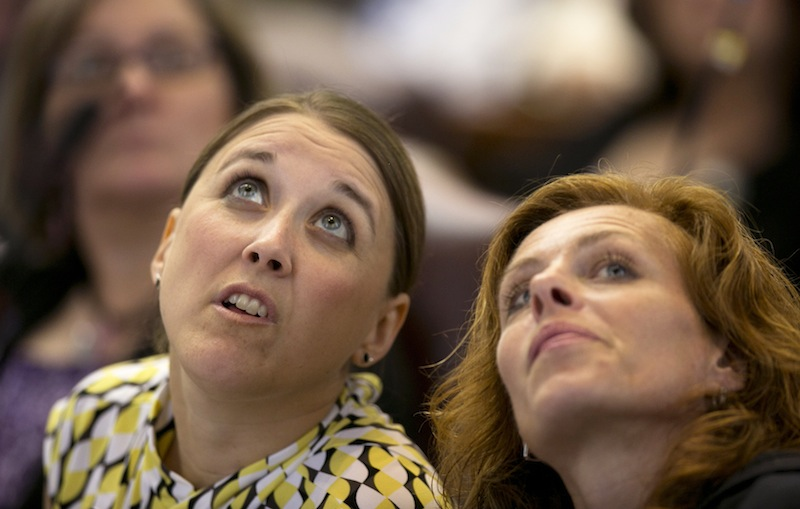 State Reps. Eleanor Espling, R-New Gloucester, left, and Amy Volk, R-Scarborough, look at the tote board during a roll call vote during a session Thursday, June 13, 2013, at the State House in Augusta, Maine. A bill that would provide health insurance to more than 60,0000 low-income Mainers was enacted by the Legislature Thursday, but it's still three votes short of a veto-proof majority. (AP Photo/Robert F. Bukaty)