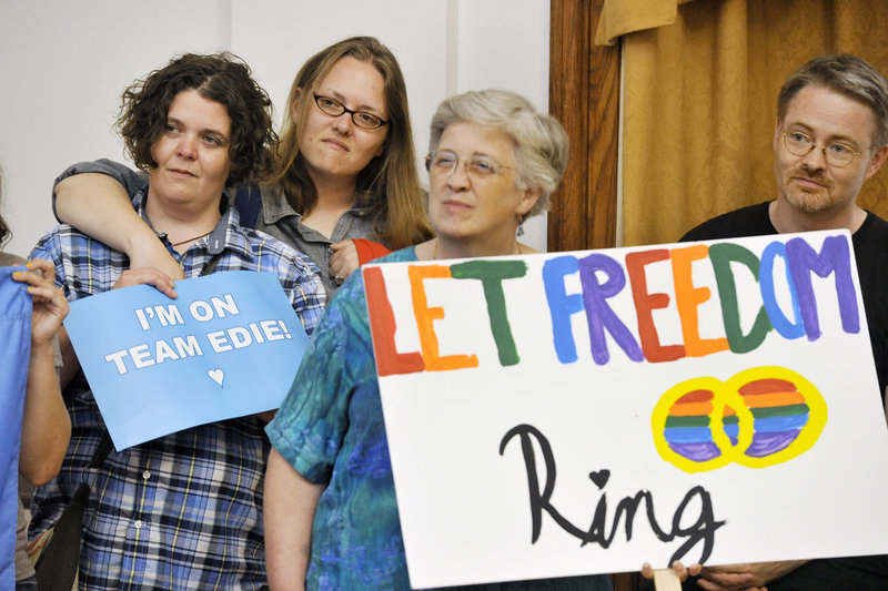 Same-sex supporters gathered at Portland City Hall to celebrate the Supreme Court's decision on Wednesday, June 26, 2013 to give the nation's legally married gay couples equal federal footing with all other married Americans. Supporters (from left) Shannon Tallman, Raminta Moore, Betsy Parsons and Jason Wilkins, all of Portland, listen to speakers at the event.