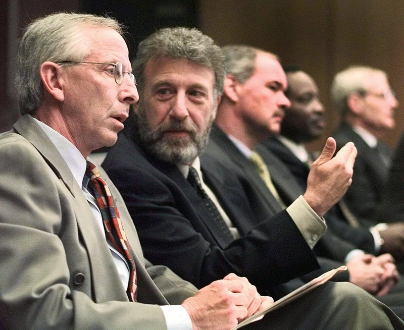 George Zimmer, second from left, has been abruptly dismissed from Men's Wearhouse Inc.