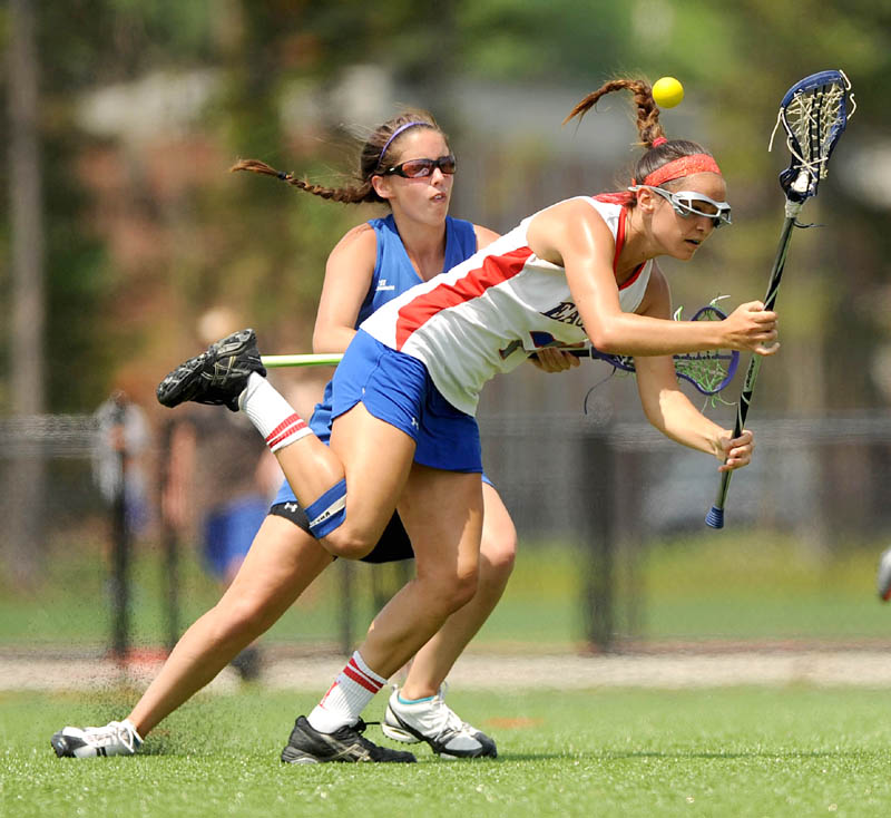 ON THE WAY TO VICTORY: Messalonskee High School's Kristy Bernatchez, front, collides with Lewiston High School's Mariah Carrier during the Eagles' 18-10 win in the Kennebec Valley Athletic Conference girls lacrosse championship game Saturday at Thomas College in Waterville.