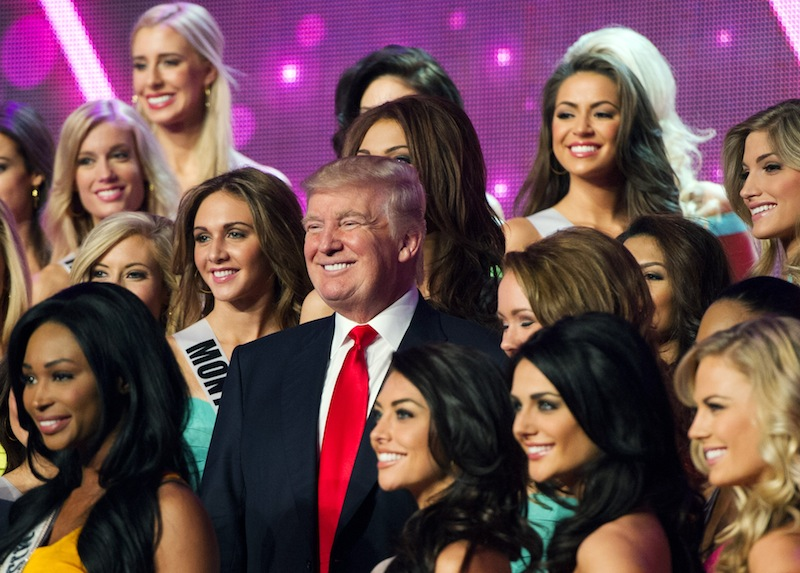 In this photo provided by the Miss Universe Organization, Donald Trump, co-owner of the Miss Universe Organization, poses for a photo with the competitors during rehearsal for the upcoming Miss USA Competition at PH Live in Las Vegas on Saturday, June 15, 2013. (AP Photo/Miss Universe Organization) Miss USA 2013;Rehearsal;Sherri Hill
