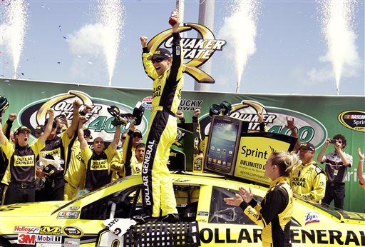 Matt Kenseth celebrates with his crew members in the winner's circle after capturing the NASCAR Sprint Cup auto race at Kentucky Speedway on Sunday in Sparta, Ky. NASCAR