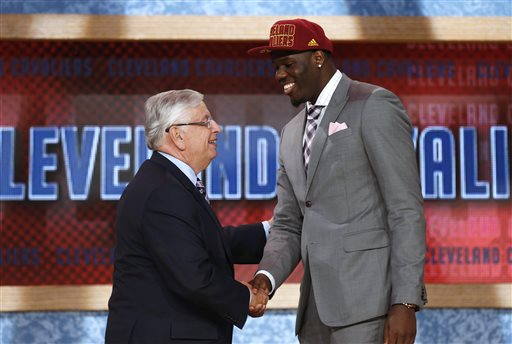 NBA Commissioner David Stern, left, shakes hands with UNLV's Anthony Bennett, who was selected first overall by the Cleveland Cavaliers in the NBA basketball draft, Thursday, June 27, 2013, in New York. (AP Photo/Jason DeCrow)