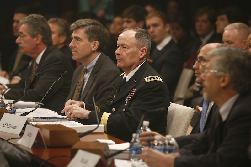 From left, Deputy Attorney General James Cole; National Security Agency (NSA) Deputy Director Chris Inglis; NSA Director Gen. Keith B. Alexander; Deputy FBI Director Sean Joyce; and Robert Litt, general counsel to the Office of the Director of National Intelligence; prepares to testify on Capitol Hill in Washington, Tuesday, June 18, 2013, before the House Intelligence Committee hearing regarding NSA surveillance. (AP Photo/Charles Dharapak)