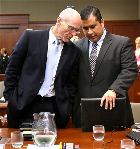 George Zimmerman, right, talks with defense attorney Don West in Seminole Circuit Court in Sanford, Fla., Monday.