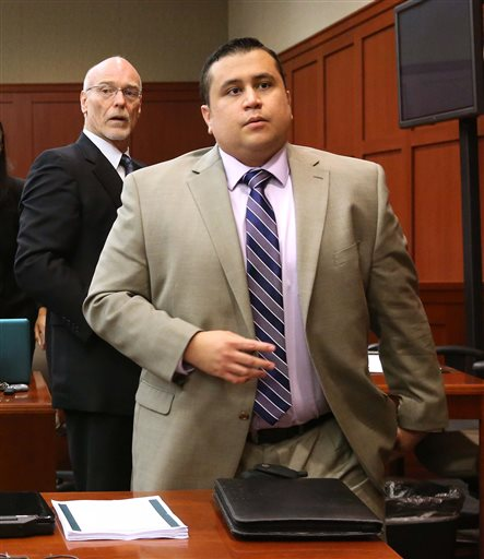 George Zimmerman, right, and attorney Don West, stand as the judge enters the courtroom in Seminole circuit court for a pretrial hearing, in Sanford, Fla., Saturday. Zimmerman has been charged with second-degree murder for the 2012 shooting death of Trayvon Martin.