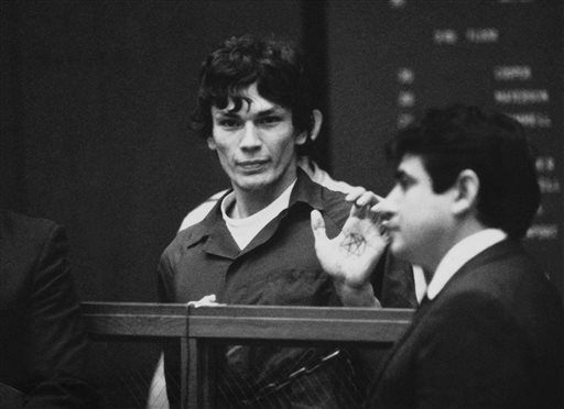 Richard Ramirez, center, know as the Night Stalker, shows a pentagram on the palm of his hand in court in this 1985 file photo. San Quentin State Prison spokesman Lt. Sam Robinson said Ramirez died Friday.