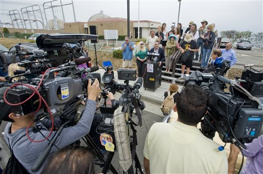 Activists gather for a news conference outside the San Onofre Nuclear Generating Station in San Clemente, Calif., Friday morning, after it was announced that the nuclear plant will be closing permanently.
