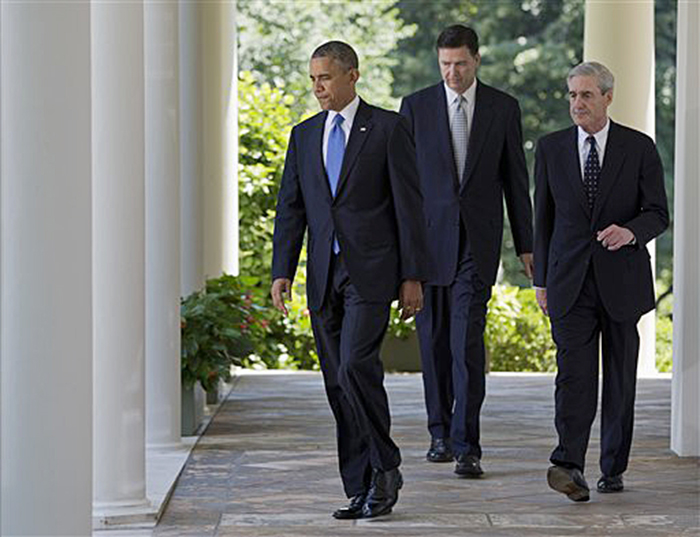 President Obama, outgoing FBI Director Robert Mueller, right, and the nominee to succeed Mueller, James Comey, walk to the Rose Garden, where the president announced Comey's nomination on Friday.