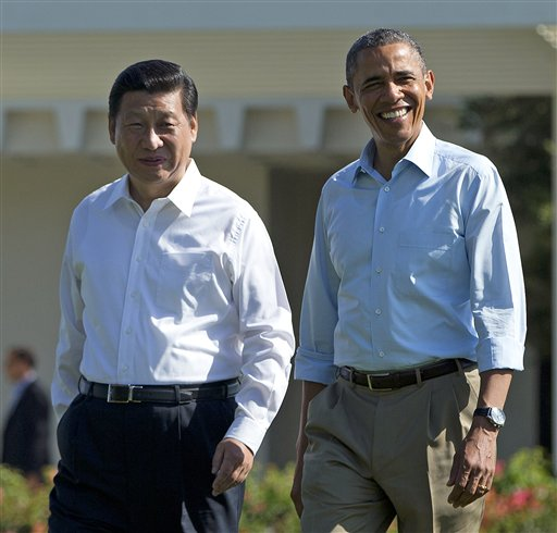 "President Barack Obama and Chinese President Xi Jinping, left, walk at the Annenberg Retreat of the Sunnylands estate Saturday in Rancho Mirage, Calif. While saying it is critical that the U.S. and China reach a ""firm understanding"" on cyber issues, Obama told reporters his meetings with Xi have been ""terrific."""