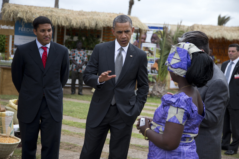 USAID administrator Raj Shah, left, and President Barack Obama talk to Nimna Diayte, president of the Farmers Federation, during a food security expo on Friday in Dakar, Senegal.