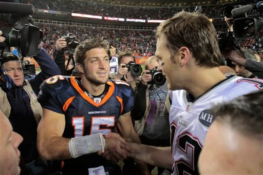 Denver Broncos quarterback Tim Tebow (15) greets New England Patriots quarterback Tom Brady (12) after a game on Sunday, Dec. 18, 2011, in Denver. Tebow will reportedly sign with the Patriots and report to mini-camp on Tuesday.