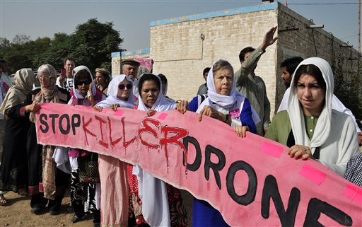 In this Oct. 7 file photo, American citizens hold a banner during a peace march organized by Pakistan's cricket star turned politician Imran Khan's party, not pictured, in Tank, Pakistan.