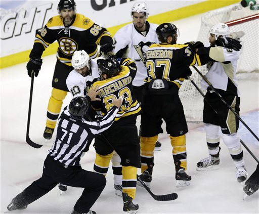 Linesman Brad Kovachik works to separate Pittsburgh Penguins left wing Brenden Morrow (10) and Boston Bruins left wing Brad Marchand (63) as they tangle in the second period of Game 4 in the Eastern Conference finals of the NHL hockey Stanley Cup playoffs, in Boston on Friday.