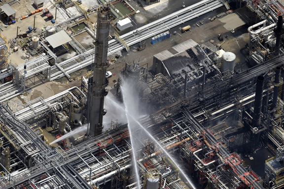 A chemical plant fire is seen in an aerial photo about twenty miles southeast of Baton Rouge, in Geismer, La., Thursday.The plant makes highly flammable gases that are basic building blocks in the petrochemical industry. (AP Photo/Gerald Herbert)