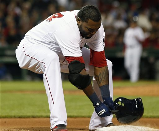 Boston Red Sox's David Ortiz slams his helmet on first base after grounding out in the eighth inning of a baseball game against the Texas Rangers in Boston, Wednesday, June 5, 2013. The Rangers won 3-2. (AP Photo/Michael Dwyer)