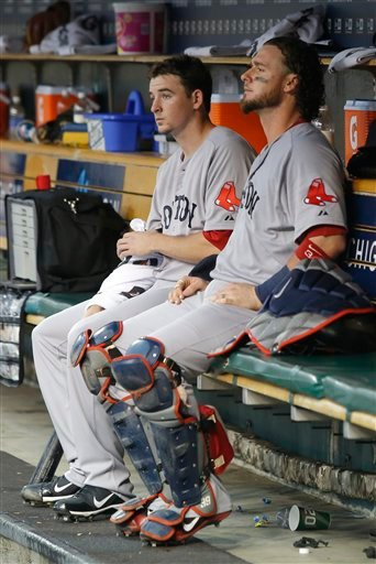 Boston Red Sox pitcher Allen Webster, left, sits in the dugout with catcher Jarrod Saltalamacchia after pitching the first inning and giving up a grand slam to Detroit Tigers catcher Victor Martinez on Saturday in Detroit. The Tigers won 10-3.