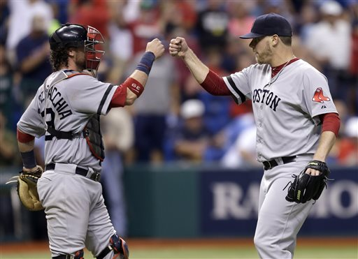 Boston Red Sox relief pitcher Andrew Bailey, right, celebrates with catcher Jarrod Saltalamacchia after closing out the Tampa Bay Rays during the ninth inning of a baseball game on Wednesday, June 12, 2013, in St. Petersburg, Fla. The Red Sox won the game 2-1. (AP Photo/Chris O'Meara) Tropicana Field;Tampa Bay Rays