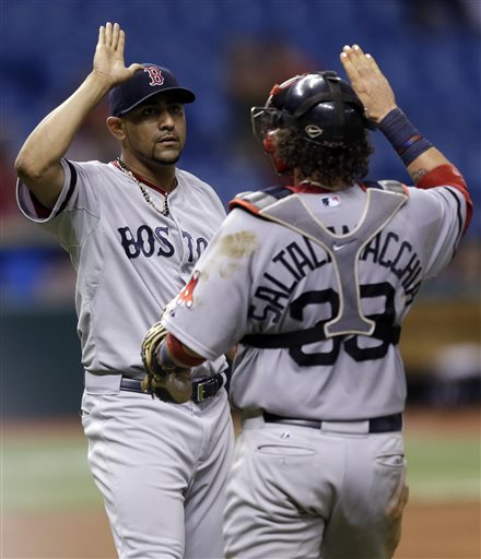 Boston Red Sox relief pitcher Franklin Morales, left, high fives catcher Jarrod Saltalamacchia after the team defeated the Tampa Bay Rays 10-8 in 14 innings during a baseball game Tuesday, June 11, 2013, in St. Petersburg, Fla. (AP Photo/Chris O'Meara) Tropicana Field;Tampa Bay Rays